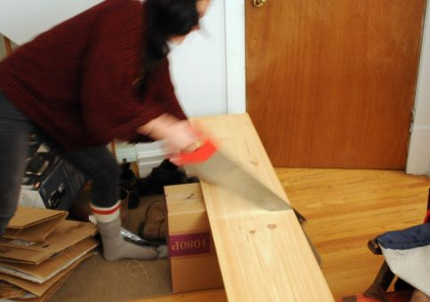 Laura sawing her first shelf
